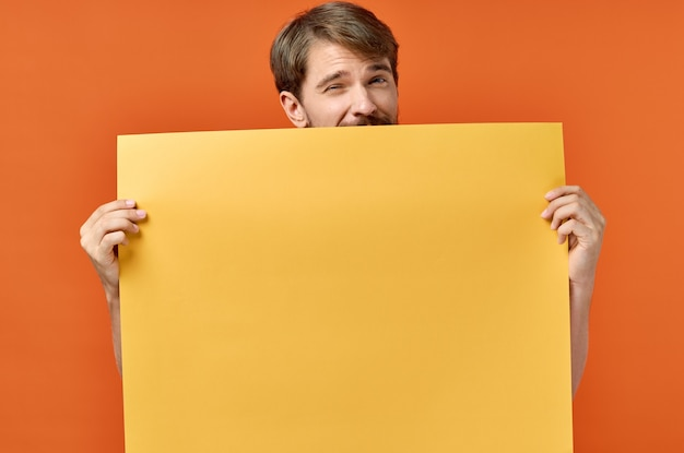 Advertising sign poster mockup man in the orange
