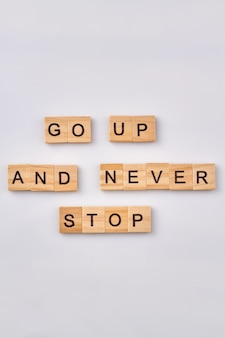 Advise for success life. motivetional phrase written with wooden blocks. isolated on white background.
