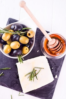 Adygei cheese with honey and olives