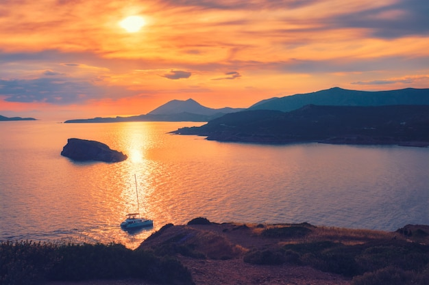 Aegean sea with islands view on sunset