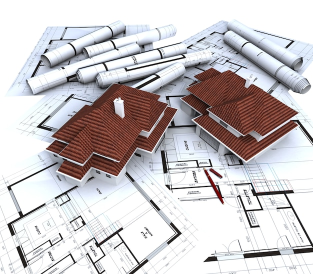 Aereal view of two house mockups with red roofs on top of architect's blueprints