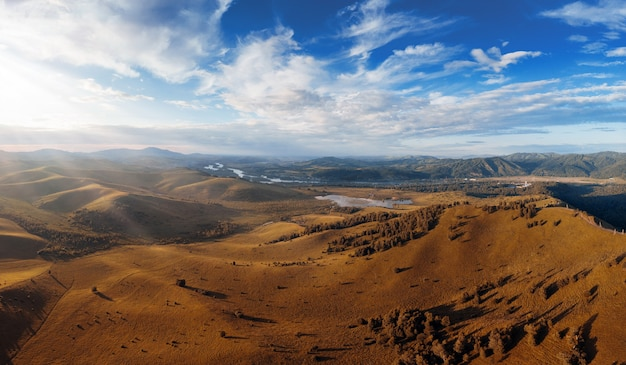Aerial autumn panorama drone shot of beauty dawn on the peak in the mountains in altay summertime