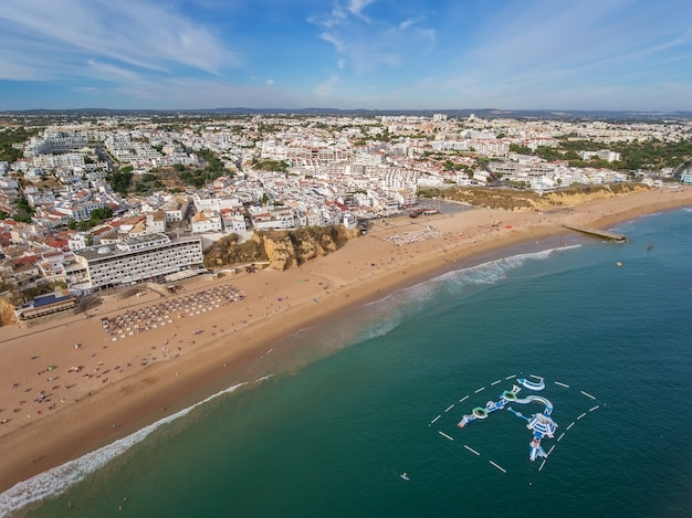 Aerial. beach in albufeira, water attractions in the summer.