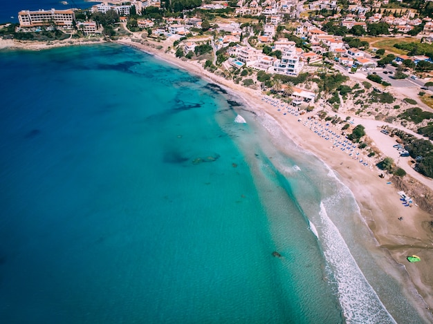 Aerial beautiful beach with crystal clear water, coral bay, cyprus