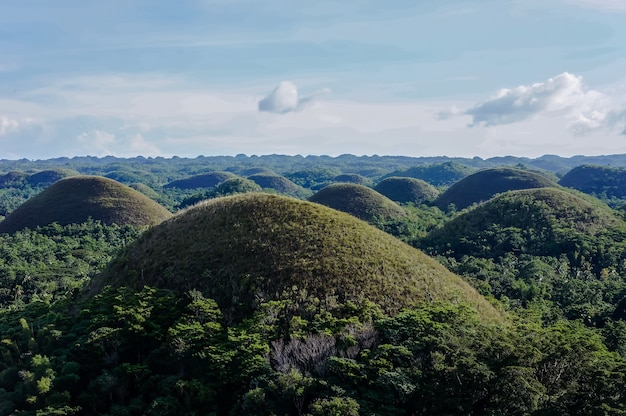 Aerial beautiful landscape of chocolate hills in cebu philippines under a blue sky