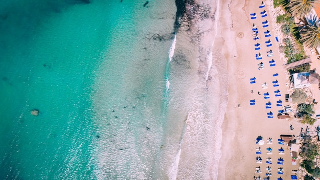 Aerial beautiful sandy beach with crystal clear water, coral bay, cyprus