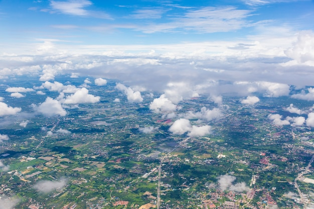 Aerial of chiang mai, thailand from an airplane showing chiang mai city through white soft clouds