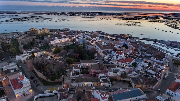 Aerial. delightful sunrise above the old town of faro portugal.
