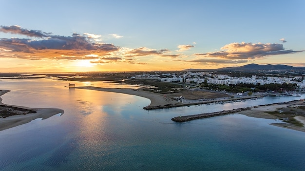 Aerial. delightful sunset over the portuguese village fuzeta, tavira.