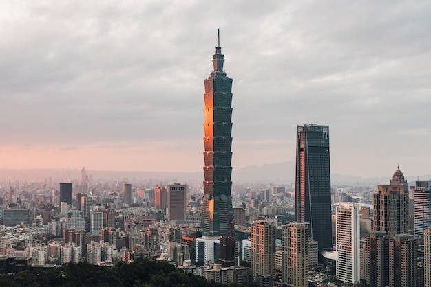 Aerial over downtown taipei with taipei 101 skyscraper in the dusk from xiangshan elephant mountain in the evening.