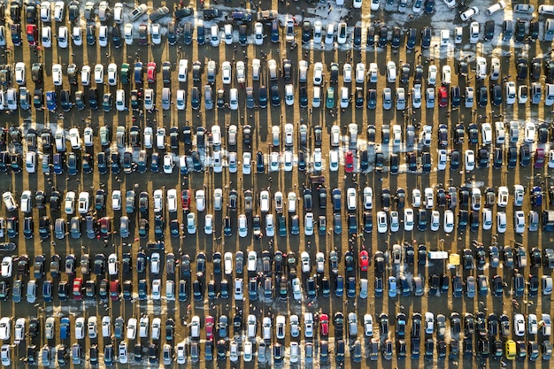Aerial drone image of many cars parked on parking lot, top view.