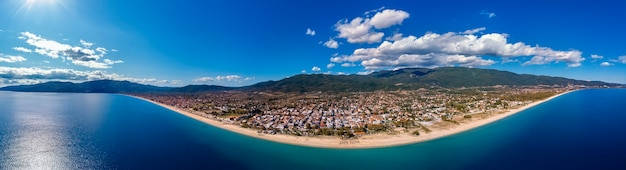 Aerial drone panorama of asprovalta city and blue sea in halkidiki, greece