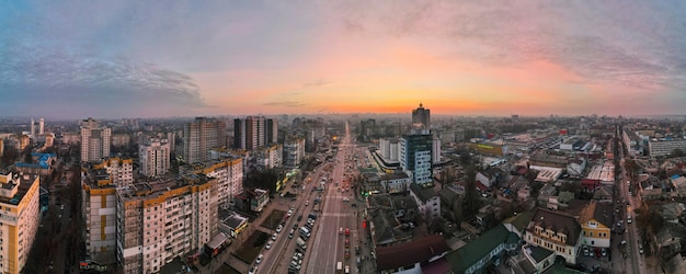 Aerial drone panorama view of chisinau, moldova at sunset. multiple residential and commercial buildings