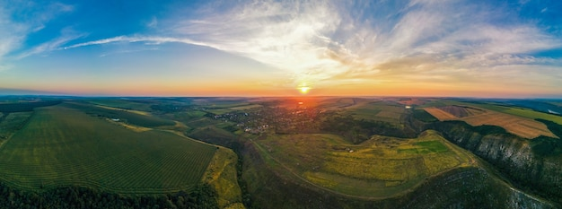 Aerial drone panorama view of nature in moldova at sunset. village, wide fields, valleys