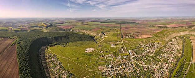 Aerial drone panoramic view of nature church valley with river and hills