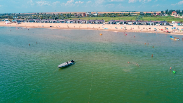 Aerial drone photo of sea bike with couple paddling