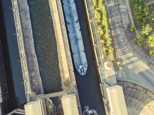 Aerial drone shot of river gateway structure for barge cargo ships.