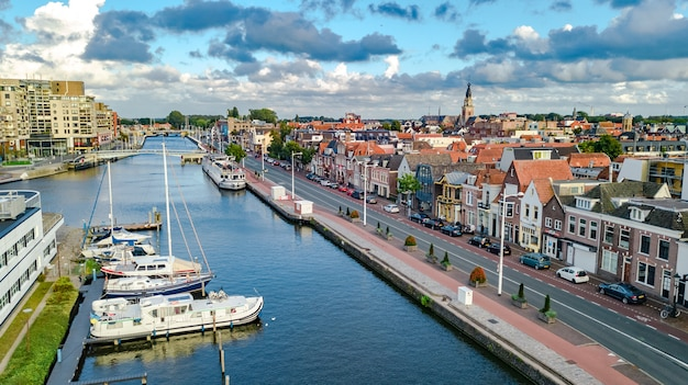 Aerial drone view of alkmaar town cityscape from above, typical dutch city skyline with canals and houses, holland, netherlands