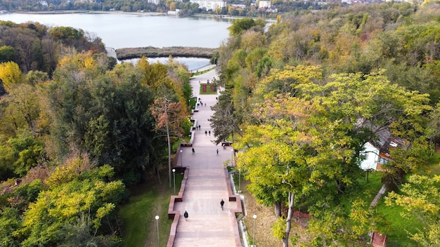 Aerial drone view of chisinau cascade staircase. multiple green trees, walking people