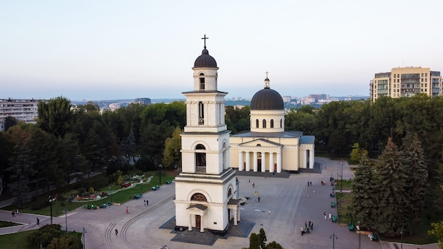 Aerial drone view of chisinau downtown. panorama view of central park with green trees and multiple walking people, cathedral, buildings