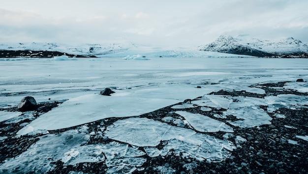 Aerial drone view glacier iceland slheimajkull melting ice climate change and global warming con