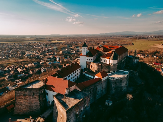Aerial drone view of the medieval palanok castle in the city of mukachevo in western ukraine
