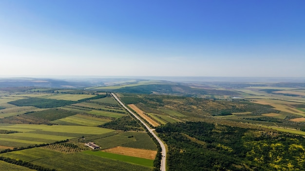 Aerial drone view of nature in moldova. highway, wide fields, forest