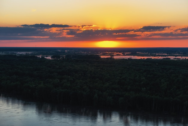 Aerial drone view of river landscape in sunny summer evening