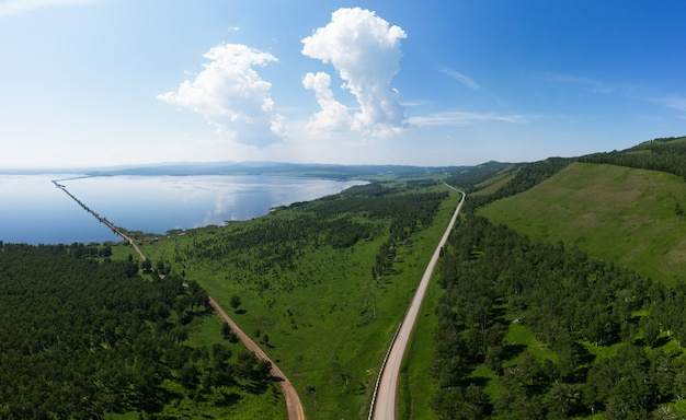 Aerial drone view of sea landscape with road