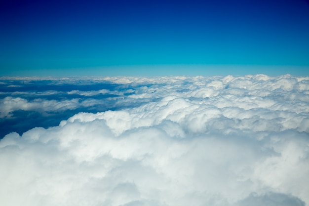 Aerial fluffy clouds view from high like a sea
