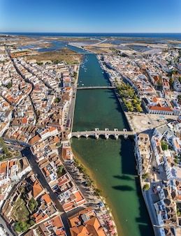 Aerial. the gilao river and bridges in the city of tavira.
