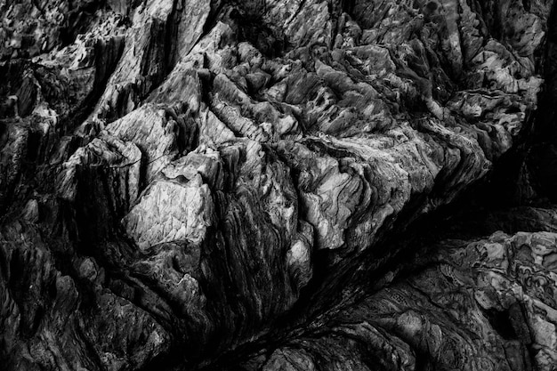 Aerial grey scale shot of the breathtaking patterns on the rocky cliffs