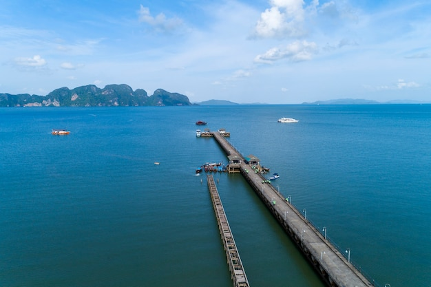 Aerial high angle view drone shot of pier with long tail boats fisherman