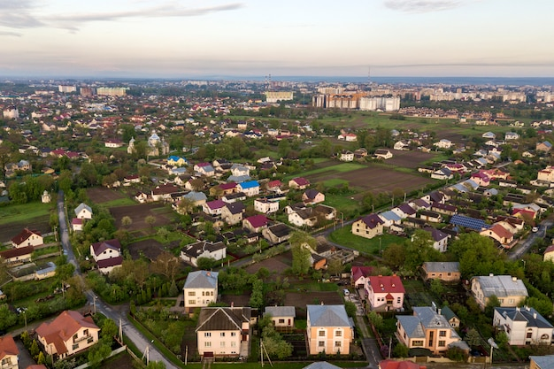 Aerial landscape of small town or village with rows of residential homes and green trees