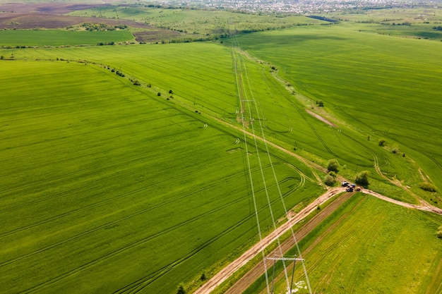 Aerial landscape view of green cultivated agricultural fields with growing crops