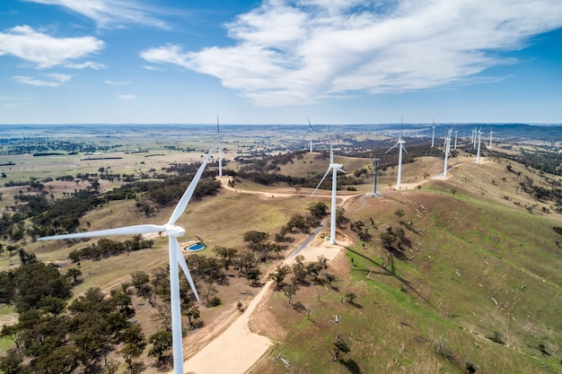 Aerial landscape of wind farm on a hill on bright sunny day in new south wales, australia