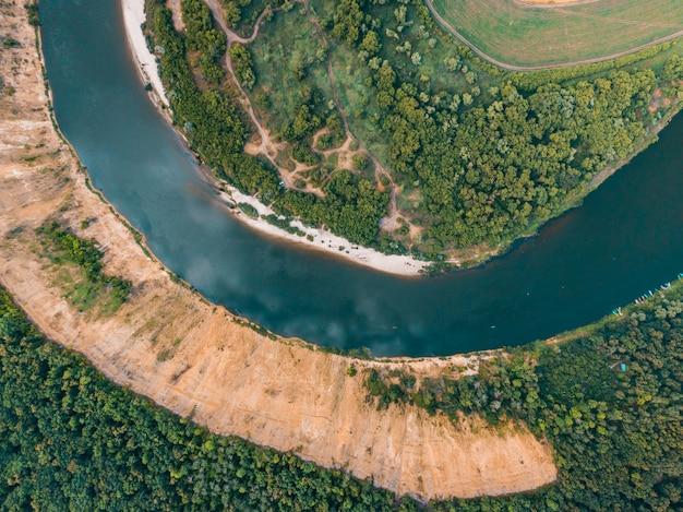 Aerial landscape of winding river in green field