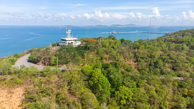 Aerial lighthouse on the coastal slopes of sriracha vts vessel traffic service
