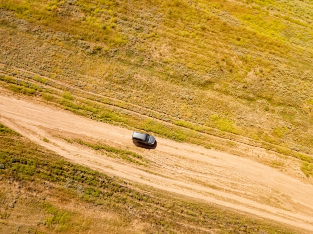 Aerial off-road truck in the summer green field  f