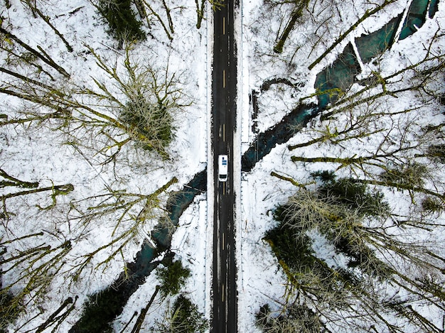 Aerial overhead shot a narrow road in mountains near steven's pass in seattle, washington dc, usa