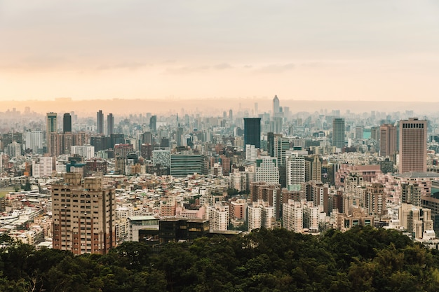 Aerial panorama over downtown taipei with layers of mountain in background