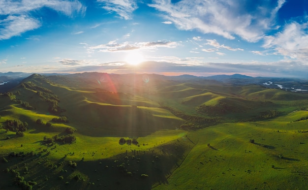 Aerial panorama drone shot of beauty dawn on the peak in the mountains in altay summertime