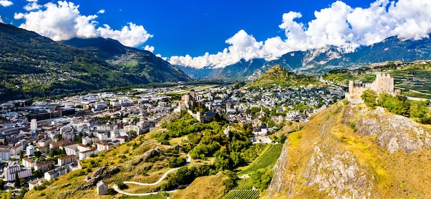 Aerial panorama of the valere basilica and tourbillon castle in sion - the canton of valais, switzerland