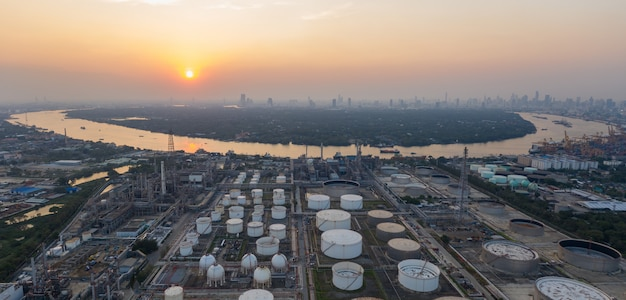 Aerial panorama view over oil refinery and river at twilight time.