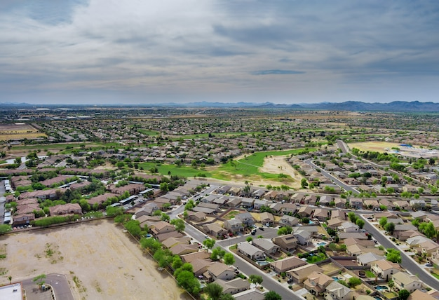 Aerial panorama view in the sleeping area with the road over avondale small town in az usa