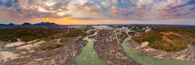 Aerial panoramic 4000 islands mekong river in laos, sunset dramatic sky, li phi waterfalls, famous travel destination backpacker in south east asia