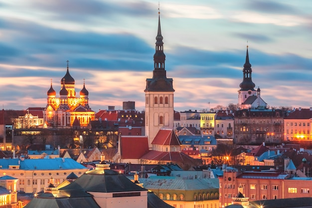 Aerial panoramic cityscape with medieval old town illuminated with saint nicholas church