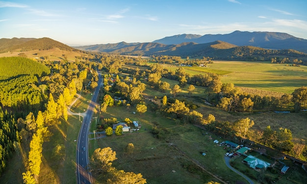 Aerial panoramic landscape of great alpine road passing through australian countryside at sunset. victoria, australia