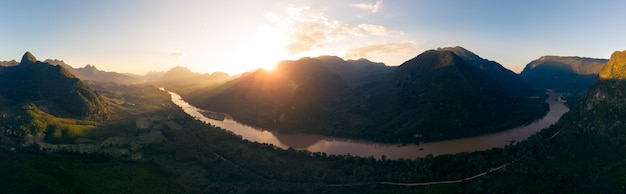 Aerial panoramic nam ou river nong khiaw muang ngoi laos, sunset dramatic sky, scenic mountain landscape