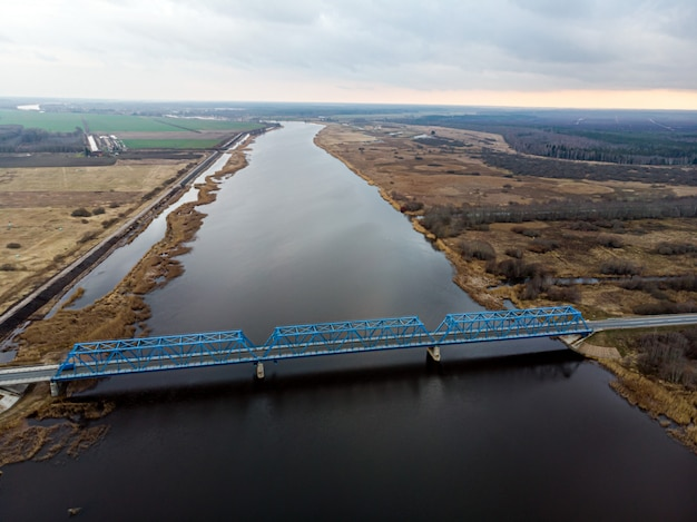 Aerial panoramic view to the bridge over the river lielupe near kalnciems, latvia